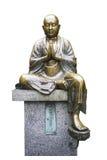 在白色背景的铜菩萨雕象孤立与workpath 库存照片