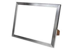 在白色背景的铝空的照片框架 库存照片