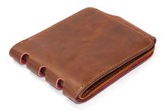 在白色背景的闭合的棕色皮革钱包 库存照片