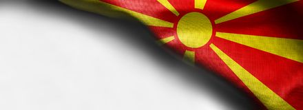 在白色背景的马其顿挥动的旗子-壁角旗子 免版税库存照片