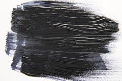 在白色背景的黑水彩刷子冲程 免版税库存照片