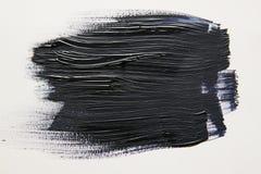 在白色背景的黑水彩刷子冲程 库存图片