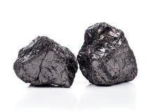 在白色背景的黑沥青煤 图库摄影