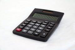 在白色背景的黑计算器 它是为做数学演算使用的某事 免版税库存图片