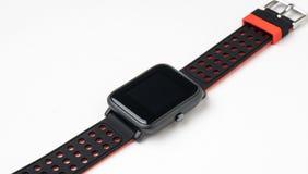 在白色背景的黑smartwatch 免版税库存照片