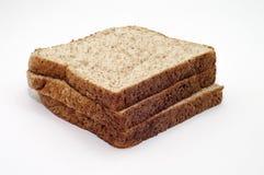 在白色背景的整个五谷面包 免版税图库摄影