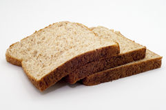 在白色背景的整个五谷面包 库存照片