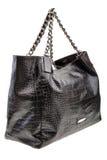在白色背景的黑人皮革妇女的袋子 免版税库存照片