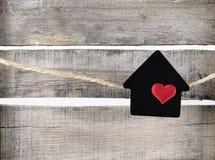 在白色背景的黑房子标志 库存图片