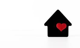 在白色背景的黑房子标志 免版税库存图片