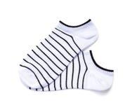 在白色背景的黑条纹袜子与裁减路线 免版税库存照片