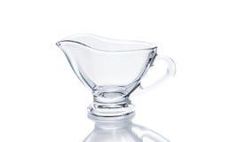 在白色背景的玻璃调味汁瓶 库存图片