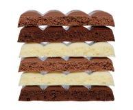 在白色背景的黑白多孔巧克力 图库摄影