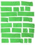在白色背景的绿色塑料透明胶带 库存照片