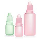 在白色背景的绿色桃红色眼药水瓶孤立 免版税库存图片