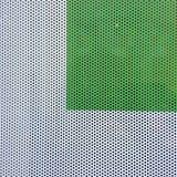 在白色背景的绿色正方形与小的孔 库存图片