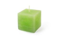 在白色背景的绿色立方体形状蜡烛 免版税库存图片