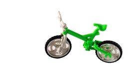 在白色背景的绿色自行车 免版税图库摄影
