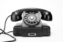 在白色背景的黑葡萄酒电话 库存图片