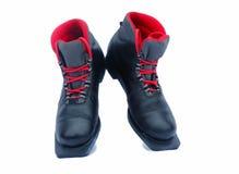 在白色背景的黑滑雪靴。 免版税库存图片