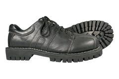 在白色背景的黑鞋子 库存照片