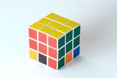 在白色背景的Rubik ` s立方体 库存照片