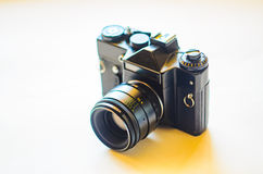 在白色背景的SLR照相机 免版税图库摄影
