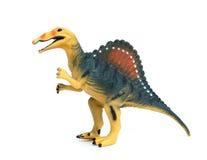 在白色背景的Spinosaurus玩具 免版税图库摄影
