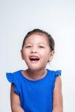 在白色背景笑的亚洲女孩特写 库存照片