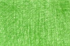 在白色背景纹理的绿色蜡笔画 免版税库存图片