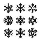 在白色背景设置的雪花象 向量 免版税库存图片