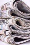 在白色背景采取的盒报纸 免版税图库摄影
