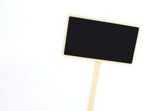 在白色背景隔绝的一个空白的黑板标签 图库摄影