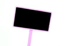 在白色背景隔绝的一个空白的黑板标签 库存图片