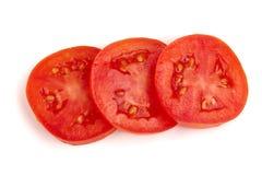 在白色背景隔绝的三个蕃茄切片 顶视图 库存图片