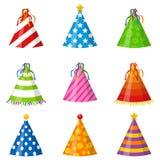 在白色背景隔绝的五颜六色的党帽子锥体集合 辅助部件,假日的标志 被设置的生日盖帽 免版税库存图片