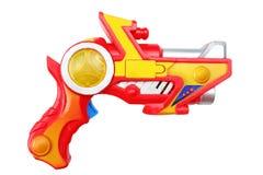 在白色背景隔绝的五颜六色的塑料手枪 免版税库存图片