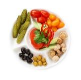 在白色背景隔绝的冷的开胃菜板材  免版税库存照片