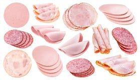 在白色背景隔绝的切片另外香肠、火腿和蒜味咸腊肠 库存图片