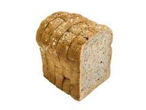 在白色背景隔绝的切片整个五谷面包 免版税库存图片