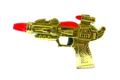 在白色背景隔绝的塑料放射枪,玩具枪 免版税库存照片
