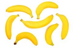 在白色背景隔绝的整个香蕉 顶视图 平的位置 无缝的模式 免版税图库摄影