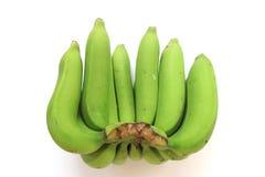 在白色背景隔绝的束绿色香蕉 库存照片