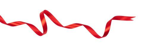 在白色背景隔绝的波浪红色丝带 图库摄影
