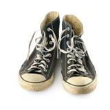 在白色背景隔绝的老被佩带的运动鞋 库存图片
