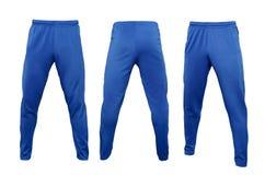 在白色背景隔绝的蓝色绑腿裤子 免版税库存照片