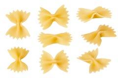 在白色背景隔绝的蝶形领结面团,顶视图 Farfalle意大利面食 免版税图库摄影