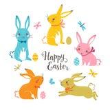 在白色背景隔绝的逗人喜爱的多彩多姿的复活节兔子 皇族释放例证