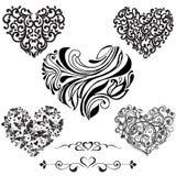 在白色背景隔绝的集合装饰黑心脏 得体 免版税图库摄影