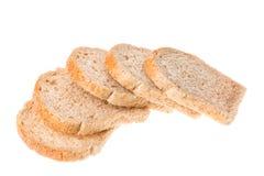 在白色背景隔绝的鲜美被切的新鲜面包片 免版税库存图片